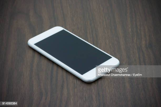 Iphone On Table Stock Photos And Pictures