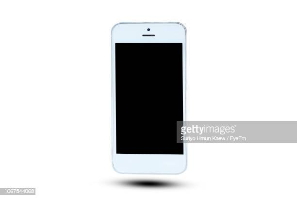 close-up of smart phone over white background - smartphone stock pictures, royalty-free photos & images