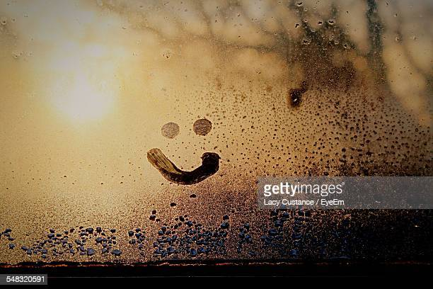 close-up of smiley on condensed glass - smiley face stock pictures, royalty-free photos & images