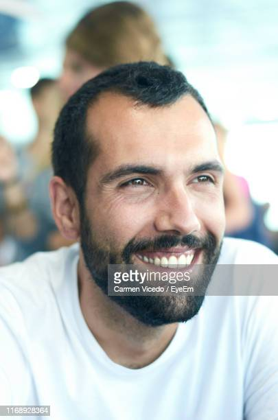 close-up of smiling bearded man looking away - receding hairline stock pictures, royalty-free photos & images