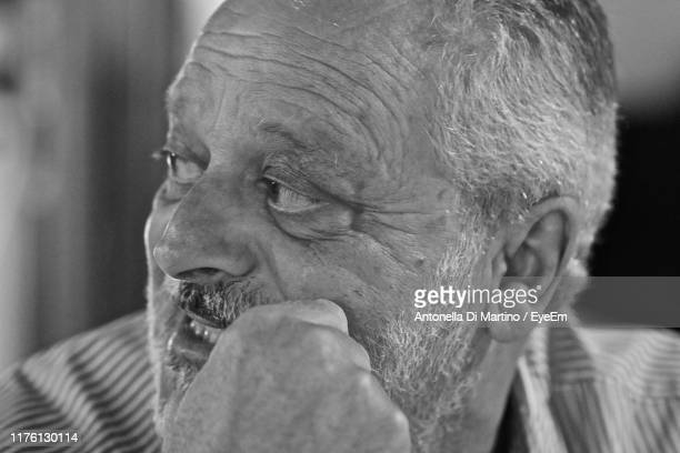 close-up of smiling bearded man - antonella di martino foto e immagini stock