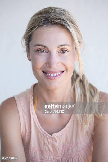 Close-up of smiling blond woman