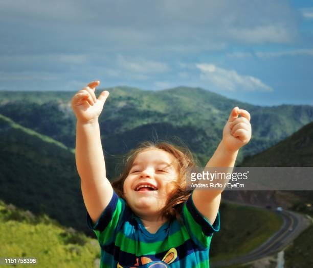 Close-Up Of Smiling Boy Against Landscape And Sky