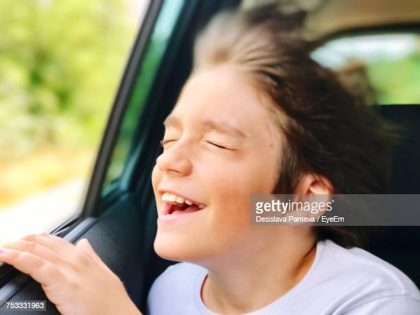 Close-Up Of Smiling Boy In Car