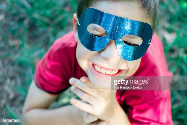 Close-Up Of Smiling Boy Wearing Mask