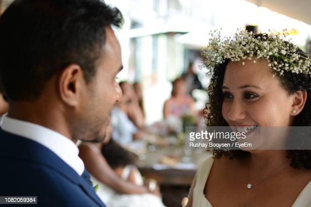 close-up of smiling bride looking at groom during wedding - port elizabeth south africa stock pictures, royalty-free photos & images