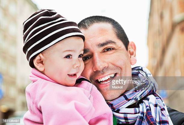 close-up of smiling father and cute daughter (0-11 months) - 0 11 monate stock-fotos und bilder