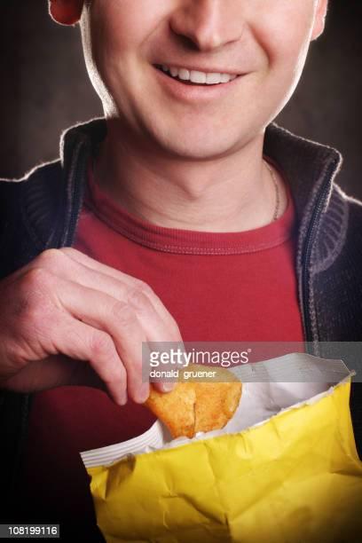 Close-up of Smiling Man Eating Potato Chips