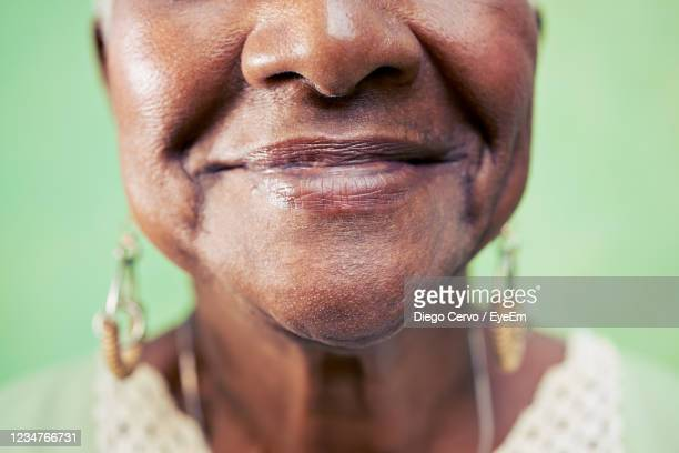 close-up of smiling senior woman - human mouth stock pictures, royalty-free photos & images