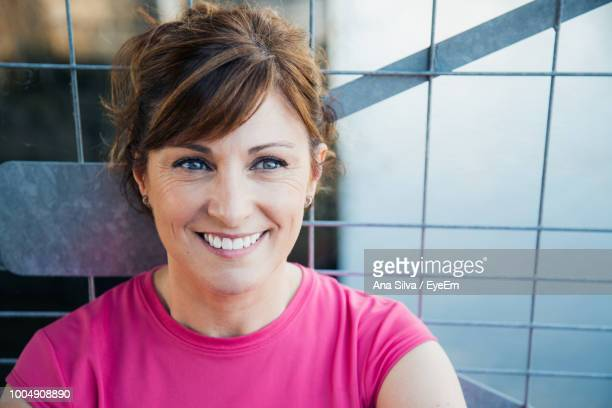 Close-Up Of Smiling Woman Against Railing