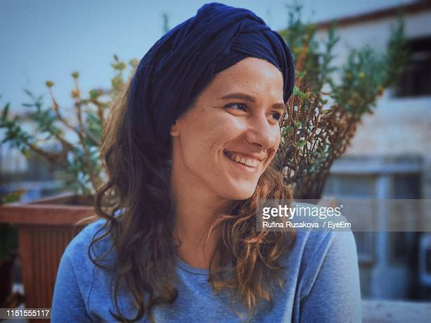 close-up of smiling woman in city - israeli woman stock pictures, royalty-free photos & images