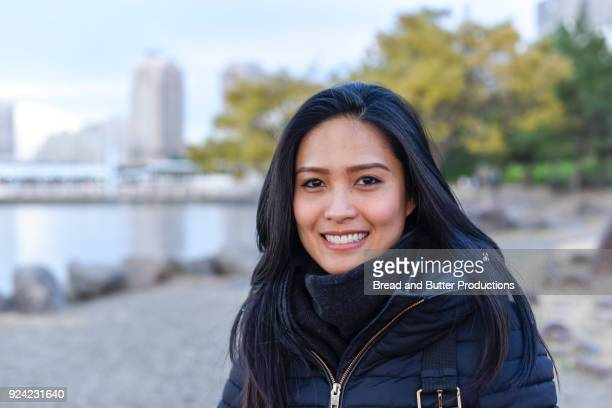 close-up of smiling woman looking at camera - 30 34 years stock pictures, royalty-free photos & images