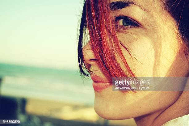Close-Up Of Smiling Woman On Beach