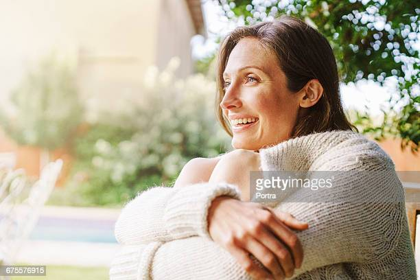 Close-up of smiling woman sitting outdoors