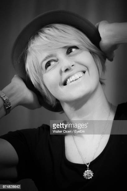 Close-Up Of Smiling Woman Wearing Hat
