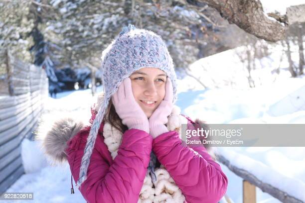Close-Up Of Smiling Woman Wearing Warm Clothing During Winter