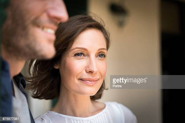 close-up of smiling woman with man - mid adult women stock pictures, royalty-free photos & images