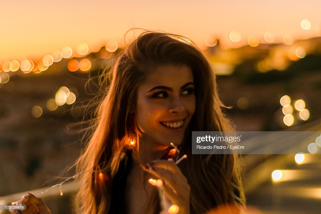 Close-Up Of Smiling Young Woman In City : Photo