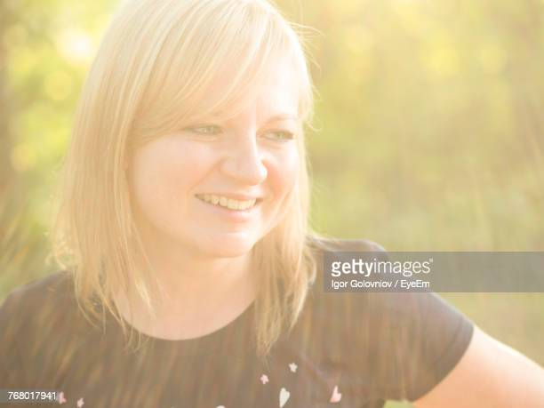 close-up of smiling young woman - igor golovniov stock pictures, royalty-free photos & images