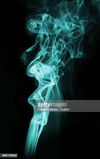 Close-Up Of Smoke Against Black Background