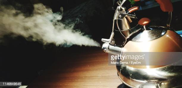 close-up of smoke emitting from tea kettle on table - steam stock pictures, royalty-free photos & images