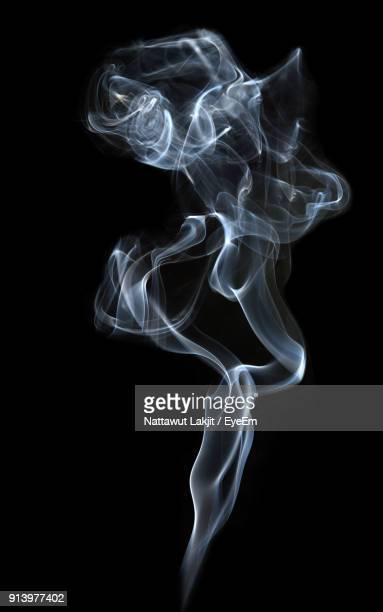 close-up of smoke over black background - fumo materia foto e immagini stock