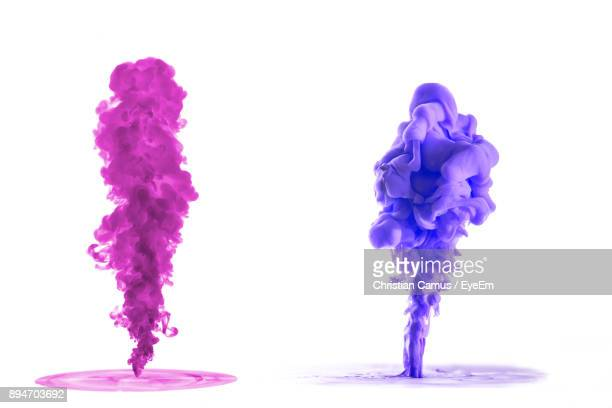 Close-Up Of Smoke Paint Against White Background