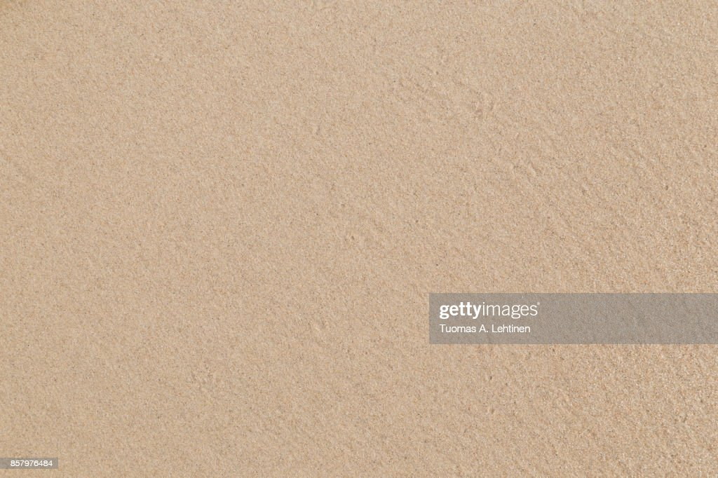 Close-up of smooth sand at a beach texture background. : Foto de stock
