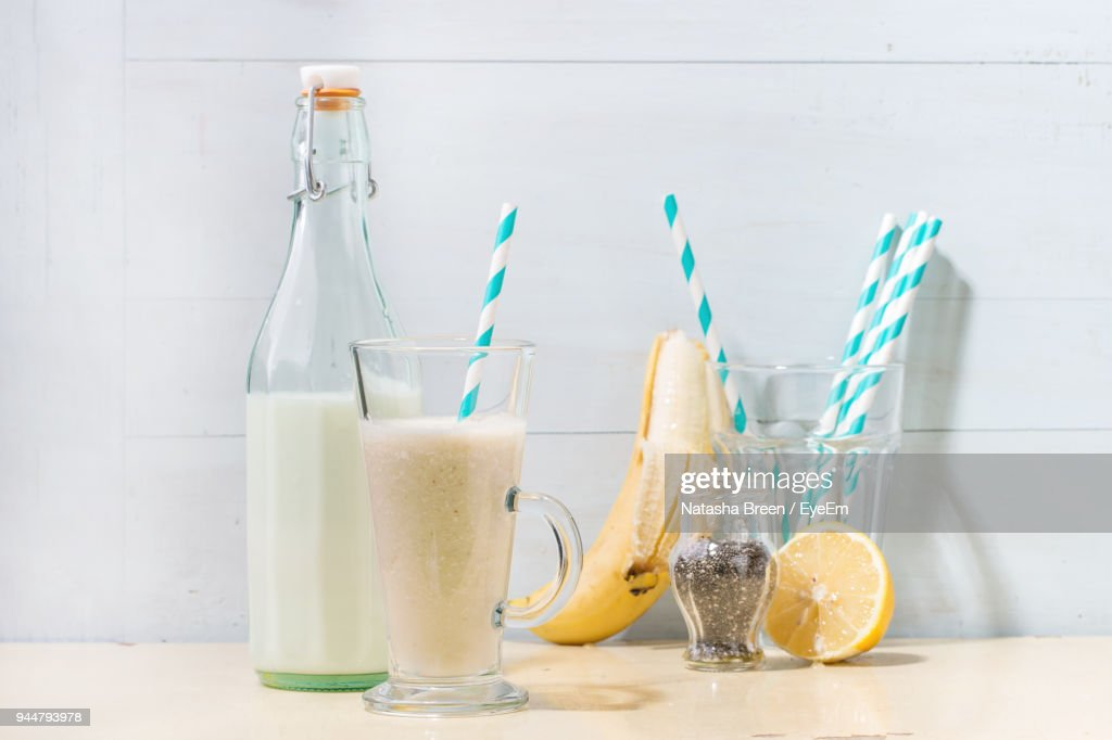 Close-Up Of Smoothie And Fruits On Wooden Table : Stock Photo
