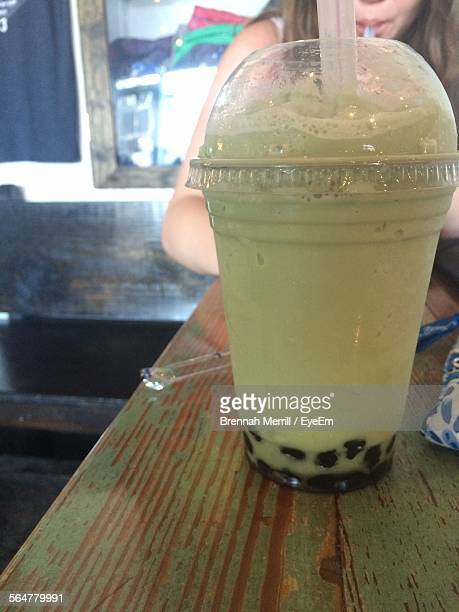 Close-Up Of Smoothie In Glass On Table