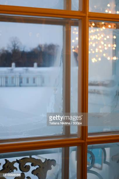 close-up of snow covered window - nikitina stock pictures, royalty-free photos & images