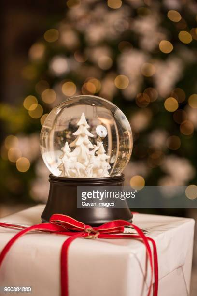 Close-up of snow globe on Christmas present