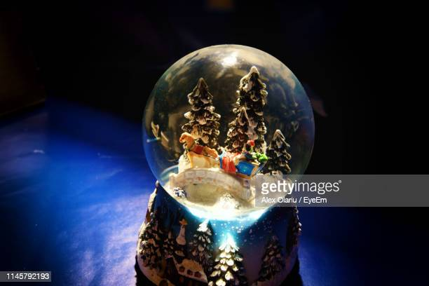 close-up of snow globe on table - alex olariu stock photos and pictures