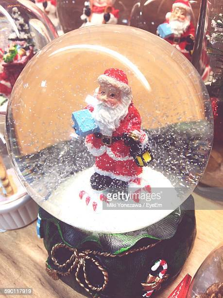 Close-Up Of Snow Globe With Santa On Table
