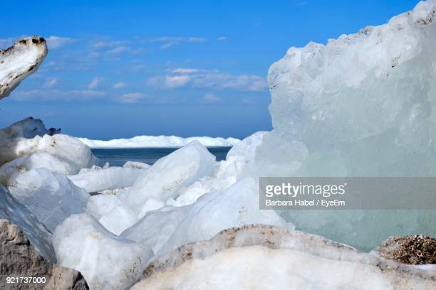 Close-Up Of Snow On Sea Against Sky