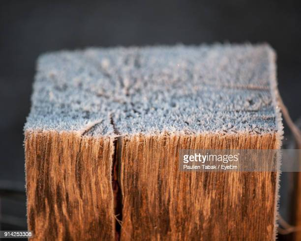Close-Up Of Snow On Wood