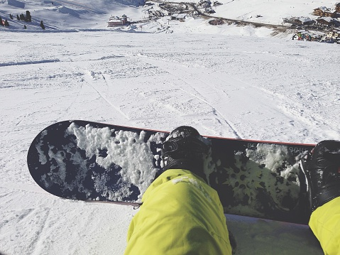 Close-Up Of Snowboarder Sitting On Snow Covered Landscape - gettyimageskorea
