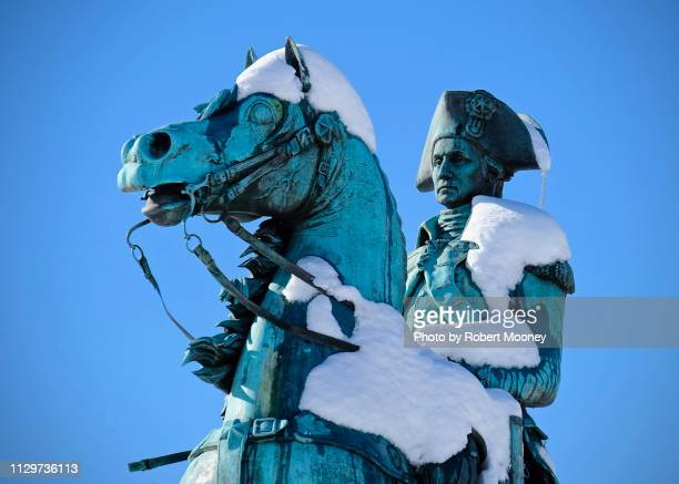 close-up of snow-covered equestrian statue of george washington in washington circle (washington, d.c.) - washington dc stock pictures, royalty-free photos & images