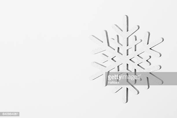 Close-up of snowflake on white background