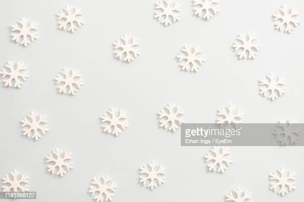 close-up of snowflakes against white background - snowflake stock pictures, royalty-free photos & images