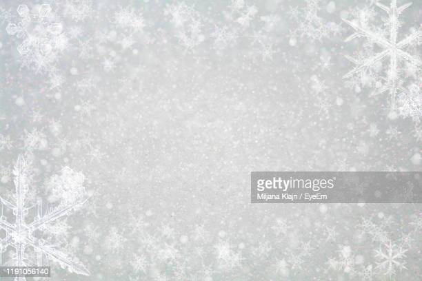 close-up of snowflakes during winter - snowflake stock pictures, royalty-free photos & images