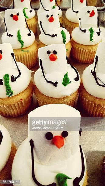 Close-Up Of Snowman Cupcakes In Store