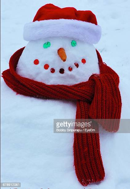 close-up of snowman - scarf stock pictures, royalty-free photos & images