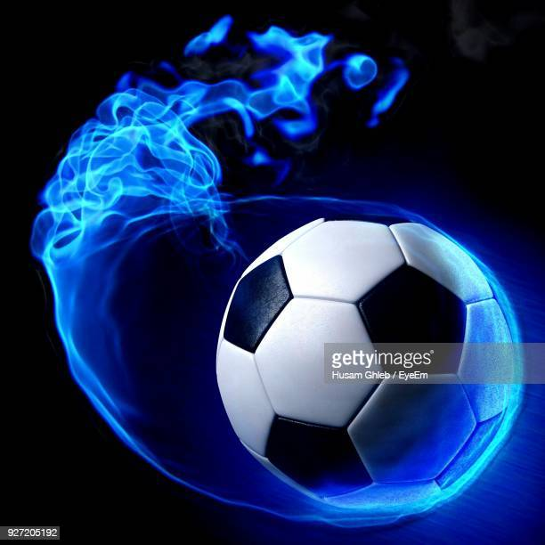 close-up of soccer ball against black background - eye black stock photos and pictures