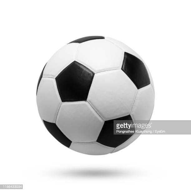 close-up of soccer ball against white background - palla sportiva foto e immagini stock