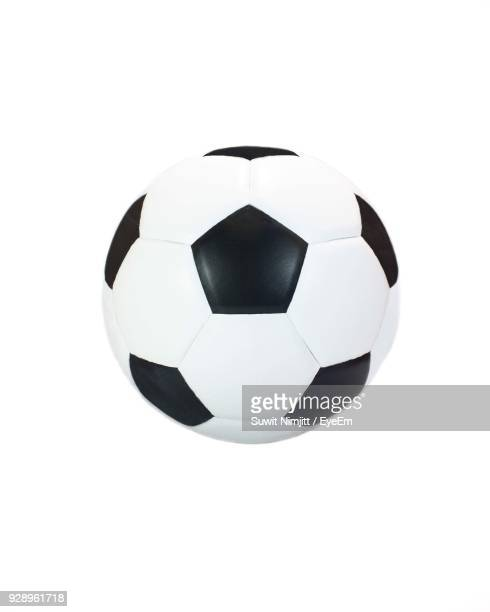 close-up of soccer ball against white background - spielball stock-fotos und bilder