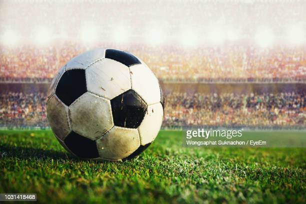 close-up of soccer ball on field - soccer stock pictures, royalty-free photos & images