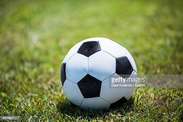 close-up of soccer ball on grassy field - football bulge stock photos and pictures