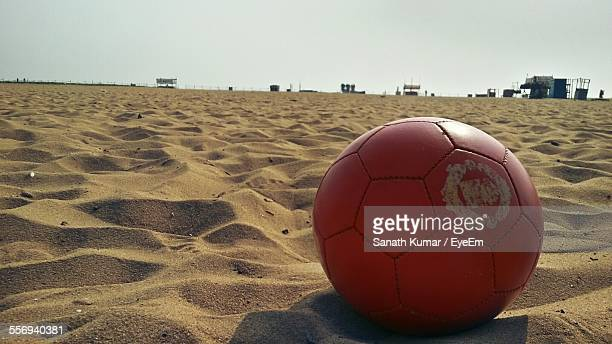Close-Up Of Soccer Ball On Sandy Beach