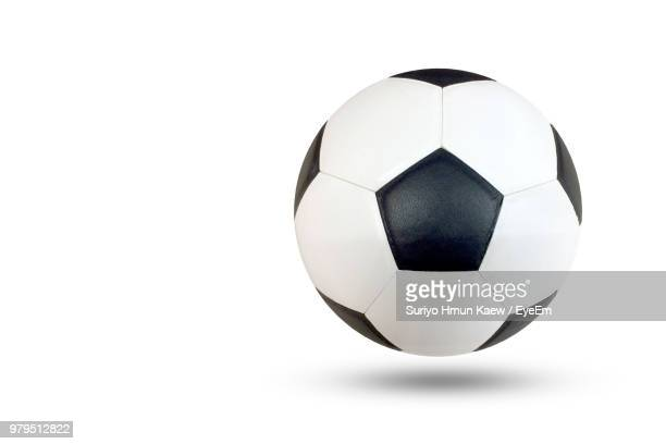 Close-Up Of Soccer Balls Levitating Against White Background